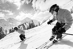 elderly couple skiing black and white